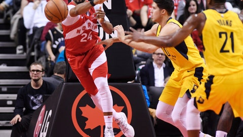 <p>               Toronto Raptors forward Norman Powell (24) passes the ball as Indiana Pacers forward Doug McDermott (20) and forward Thaddeus Young (21) look on during second half NBA basketball action in Toronto on Sunday, Jan. 6, 2019. (Nathan Denette/The Canadian Press via AP)             </p>