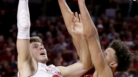 <p>               Wisconsin's Ethan Happ (22) goes for a layup against Nebraska's Isaiah Roby (15) during the first half of an NCAA college basketball game in Lincoln, Neb., Tuesday, Jan. 29, 2019. (AP Photo/Nati Harnik)             </p>