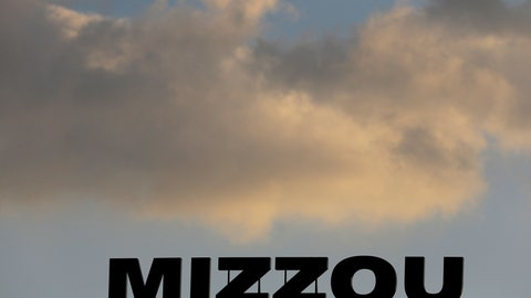 <p>               In this Nov. 2, 2013, file photo, the Mizzou logo is seen on a scoreboard over Memorial Stadium at Faurot Field before the start of an NCAA college football game between Missouri and Tennessee in Columbia, Mo. The NCAA has sanctioned Missouri's football, baseball and softball programs on Thursday, Jan. 31, 2019, after an investigation revealed academic misconduct involving a tutor who completed coursework for athletes.  (AP Photo/Jeff Roberson, File)             </p>