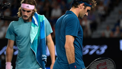 <p>               Switzerland's Roger Federer, right, and Greece's Stefanos Tsitsipas walk to their chairs during a break in their fourth round match at the Australian Open tennis championships in Melbourne, Australia, Sunday, Jan. 20, 2019. (AP Photo/Andy Brownbill)             </p>