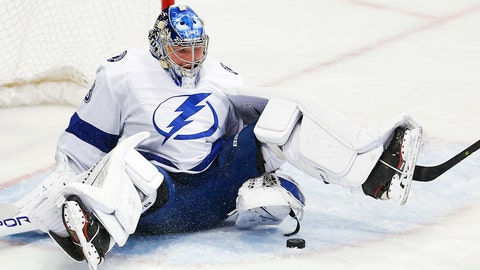 <p>               Tampa Bay Lightning goaltender Andrei Vasilevskiy (88) stops a shot during the first period of an NHL hockey game against the Dallas Stars, Tuesday, Jan. 15, 2019, in Dallas. (AP Photo/Brandon Wade)             </p>