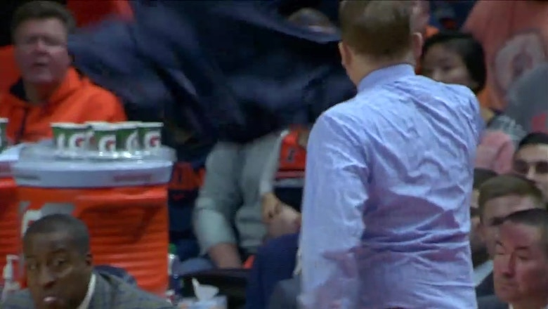 Illinois head coach Brad Underwood tosses his jacket into the stands in anger