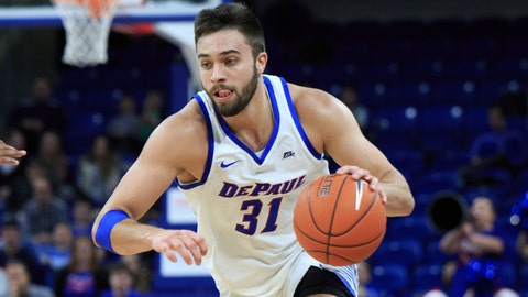 CHICAGO, ILLINOIS - DECEMBER 22: Max Strus #31  of the DePaul Blue Demons drives to the basket in the game against the Boston College Eagles in the second half at Wintrust Arena on December 22, 2018 in Chicago, Illinois.(Photo by Justin Casterline/Getty Images)