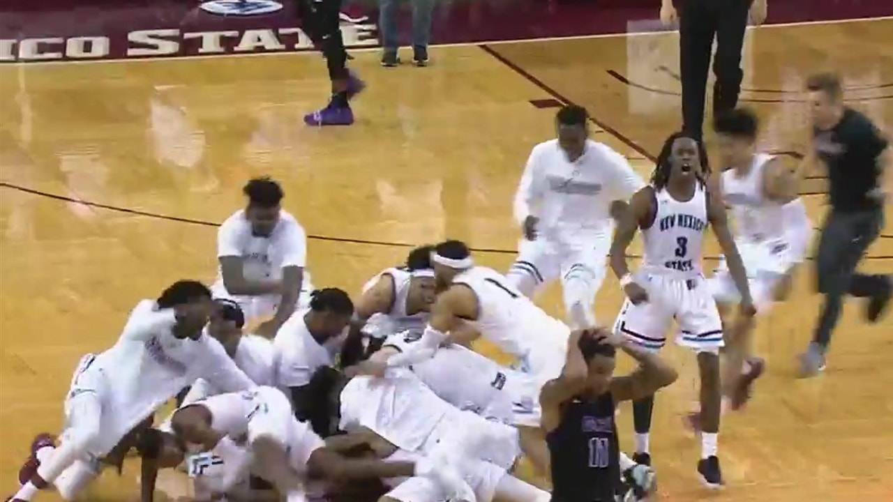 Johnny McCants hits a 50-foot half court buzzer beater to win the game for  the New Mexico State Aggies