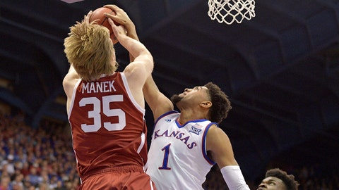 Jan 2, 2019; Lawrence, KS, USA; Kansas Jayhawks forward Dedric Lawson (1) blocks the shot of Oklahoma Sooners forward Brady Manek (35) during the first half at Allen Fieldhouse. Mandatory Credit: Denny Medley-USA TODAY Sports