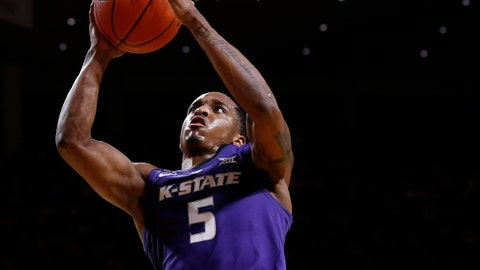 AMES, IA - JANUARY 12: Barry Brown Jr. #5 of the Kansas State Wildcats takes the game winning shot over Nick Weiler-Babb #1 of the Iowa State Cyclones in the second half of play at Hilton Coliseum on January 12, 2019 in Ames, Iowa. The Kansas State Wildcats won 58-57 over the Iowa State Cyclones. (Photo by David Purdy/Getty Images)