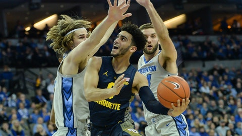Jan 9, 2019; Omaha, NE, USA; Marquette Golden Eagles guard Markus Howard (0) attempts a shot between Creighton Bluejays center Samson Froling (31) and guard Mitch Ballock (24) in the first half at CHI Health Center Omaha. Mandatory Credit: Steven Branscombe-USA TODAY Sports