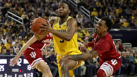 ANN ARBOR, MICHIGAN - JANUARY 06:  Zavier Simpson #3 of the Michigan Wolverines drives between Devonte Green #11 and Zach McRoberts #15 of the Indiana Hoosiers during the first half at Crisler Arena on January 06, 2019 in Ann Arbor, Michigan. (Photo by Gregory Shamus/Getty Images)