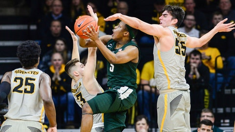 Jan 24, 2019; Iowa City, IA, USA; Iowa Hawkeyes forward Luka Garza (55) and guard Jordan Bohannon (3) and forward Tyler Cook (25) defend the shot by Michigan State Spartans guard Cassius Winston (5) during the first half at Carver-Hawkeye Arena. Mandatory Credit: Jeffrey Becker-USA TODAY Sports