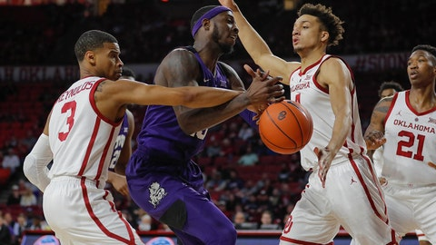 Jan 12, 2019; Norman, OK, USA; TCU Horned Frogs forward JD Miller (15) and Oklahoma Sooners guard Miles Reynolds (3) and Sooners center Jamuni McNeace (4) compete for a loose ball during the first half at Lloyd Noble Center. Mandatory Credit: Alonzo Adams-USA TODAY Sports
