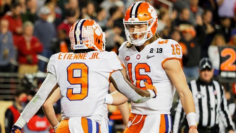 Jan 7, 2019; Santa Clara, CA, USA; Clemson Tigers running back Travis Etienne (9) and quarterback Trevor Lawrence (16) celebrate a touchdown during the second quarter against the Alabama Crimson Tide in the 2019 College Football Playoff Championship game at Levi's Stadium. Mandatory Credit: Kelley L Cox-USA TODAY Sports