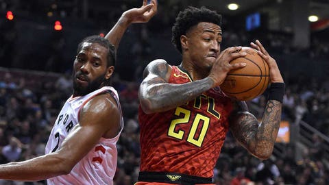 Jan 8, 2019; Toronto, Ontario, CAN;  Atlanta Hawks forward John Collins (20) takes a rebound away from Toronto Raptors forward Kawhi Leonard (2) in the second half at Scotiabank Arena. Mandatory Credit: Dan Hamilton-USA TODAY Sports