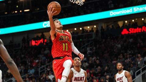 Jan 6, 2019; Atlanta, GA, USA; Atlanta Hawks guard Trae Young (11) scores a basket past Miami Heat forward Rodney McGruder (17) during the second half at State Farm Arena. Mandatory Credit: Dale Zanine-USA TODAY Sports