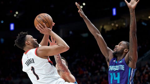 Jan. 11, 2019; Portland, OR, USA; Portland Trail Blazers guard Evan Turner (1) shoots over Charlotte Hornets forward Michael Kidd-Gilchrist (14) during the third quarter at the Moda Center. Mandatory Credit: Craig Mitchelldyer-USA TODAY Sports