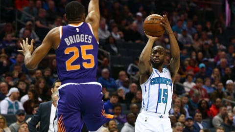 Jan 19, 2019; Charlotte, NC, USA; Charlotte Hornets guard Kemba Walker (15) shoots the ball against Phoenix Suns forward Mikal Bridges (25) in the first half at Spectrum Center. Mandatory Credit: Jeremy Brevard-USA TODAY Sports