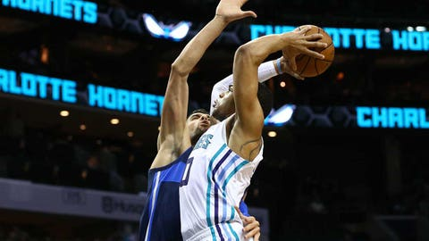 Jan 2, 2019; Charlotte, NC, USA; Charlotte Hornets forward Miles Bridges (0) goes up to dunk the ball against Dallas Mavericks center Salah Mejri (50) in the second half at Spectrum Center. Mandatory Credit: Jeremy Brevard-USA TODAY Sports