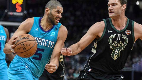 Jan 25, 2019; Milwaukee, WI, USA;  Charlotte Hornets forward Nicolas Batum (5) drives for the basket against Milwaukee Bucks center Brook Lopez (11) on the third quarter at the Fiserv Forum. Mandatory Credit: Benny Sieu-USA TODAY Sports
