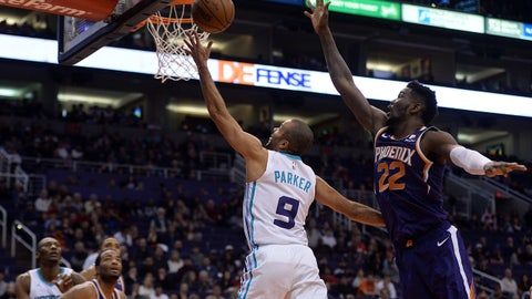 Jan 6, 2019; Phoenix, AZ, USA; Charlotte Hornets guard Tony Parker (9) puts up a layup against Phoenix Suns center Deandre Ayton (22) during the second half at Talking Stick Resort Arena. Mandatory Credit: Joe Camporeale-USA TODAY Sports