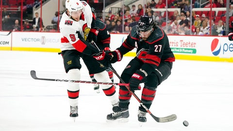 Jan 18, 2019; Raleigh, NC, USA;  Carolina Hurricanes defenseman Justin Faulk (27) blocks Ottawa Senators right wing Bobby Ryan (9) third period shot attempt at PNC Arena. The Ottawa Senators defeated the Carolina Hurricanes 4-1. Mandatory Credit: James Guillory-USA TODAY Sports
