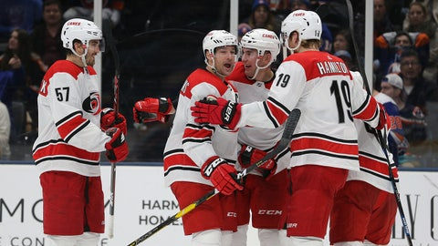 Jan 8, 2019; Uniondale, NY, USA; Carolina Hurricanes right wing Justin Williams (14) celebrates with teammates after scoring a goal against the New York Islanders during the third period at Nassau Veterans Memorial Coliseum. Mandatory Credit: Brad Penner-USA TODAY Sports