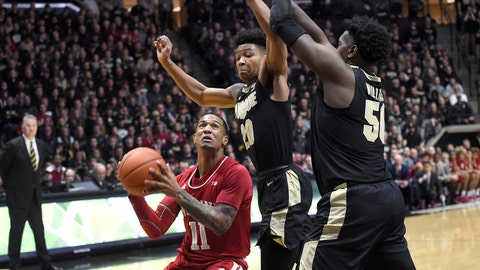 Jan 19, 2019; West Lafayette, IN, USA; Indiana Hoosiers guard Devonte Green (11) drives and looks for a shot as Purdue Boilermakers guard Nojel Eastern (20) and forward Trevion Williams (50) defend in the first half at Mackey Arena. Mandatory Credit: Sandra Dukes-USA TODAY Sports