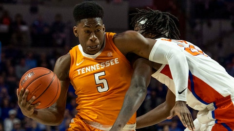 Jan 12, 2019; Gainesville, FL, USA; Tennessee Volunteers guard Admiral Schofield (5) drives for the basket as Florida Gators forward Dontay Bassett (21) defends during the first half at Exactech Arena. Mandatory Credit: Douglas DeFelice-USA TODAY Sports