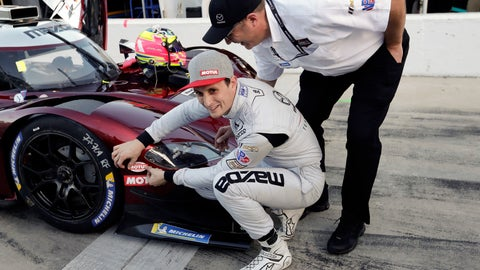 <p>               Oliver Jarvis, left, of Great Britain, applies a decal to the front of his car as Mazda Director of Motorsports John Doonan, looks on after Jarvis qualified for the pole position for the IMSA 24 hour race at Daytona International Speedway, Thursday, Jan. 24, 2019, in Daytona Beach, Fla. (AP Photo/John Raoux)             </p>