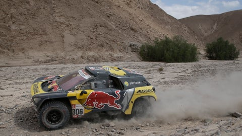 <p>               Driver Sebastien Loeb, of France, and co-driver Daniel Elena, of Monaco, race their Peugeot during stage four of the Dakar Rally between Arequipa and Moquegua, Peru, Thursday, Jan. 10, 2019. (AP Photo/Ricardo Mazalan)             </p>