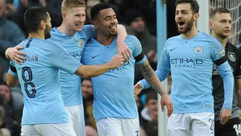 <p>               Left to right, Manchester City's Ilkay Gundogan, Kevin De Bruyne, Gabriel Jesus and Manchester City's Bernardo Silva celebrate after scoring their side's opening goal during the FA Cup 4th round soccer match between Manchester City and Burnley at Etihad stadium in Manchester, England, Saturday, Jan. 26, 2019. (AP Photo/Rui Vieira)             </p>