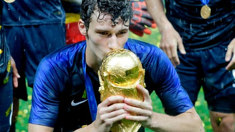 <p>               FILE -- In this Sunday, July 15, 2018 photo France's Benjamin Pavard kisses the cup during the trophy ceremony after the final match between France and Croatia at the 2018 soccer World Cup in the Luzhniki Stadium in Moscow, Russia. German Bundesliga soccer team FC Bayern Munich has signed France defender Benjamin Pavard from Bundesliga rival Stuttgart for next season. (AP Photo/Matthias Schrader, file)             </p>