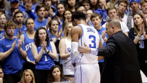 <p>               Duke's Tre Jones (3) is escorted from the court following an injury during the first half of an NCAA college basketball game against Syracuse in Durham, N.C., Monday, Jan. 14, 2019. No. 1-for-now Duke will have to figure out how to play without perhaps its most irreplaceable player now that point guard Tre Jones is out indefinitely with a shoulder injury. (AP Photo/Gerry Broome)             </p>