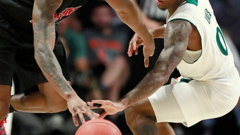 <p>               North Carolina State guard C.J. Bryce, left, attempts to drive past Miami guard Chris Lykes (0) during the first half of an NCAA college basketball game, Thursday, Jan. 3, 2019, in Coral Gables, Fla. (AP Photo/Wilfredo Lee)             </p>