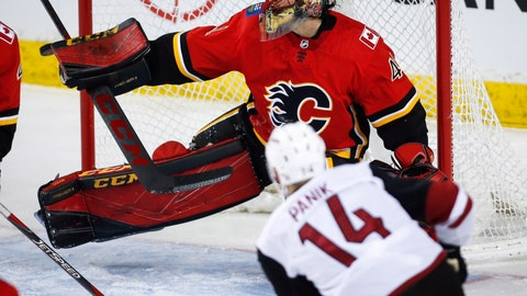 <p>               Arizona Coyotes' Richard Panik, right, of the Czech Republic, has his shot deflected by Calgary Flames goalie Mike Smith during the first period of an NHL hockey game, Sunday, Jan. 13, 2019, in Calgary, Alberta. (Jeff McIntosh/The Canadian Press via AP)             </p>