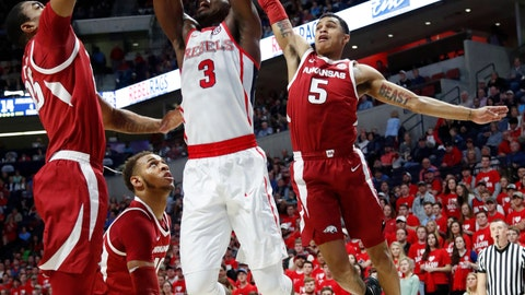 <p>               Mississippi guard Terence Davis' (3) dunk attempt is blocked by Arkansas guard Jalen Harris (5) and forward Reggie Chaney (35) during the first half of the NCAA college basketball game in Oxford, Miss., Saturday, Jan. 19, 2019. (AP Photo/Rogelio V. Solis)             </p>