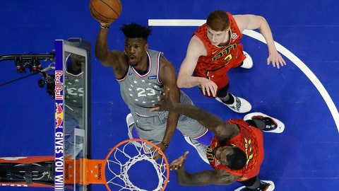 <p>               Philadelphia 76ers' Jimmy Butler (23) shoots next to Atlanta Hawks' Dewayne Dedmon (14) and Kevin Huerter (3) during the first half of an NBA basketball game Friday, Jan. 11, 2019, in Philadelphia. (AP Photo/Matt Slocum)             </p>