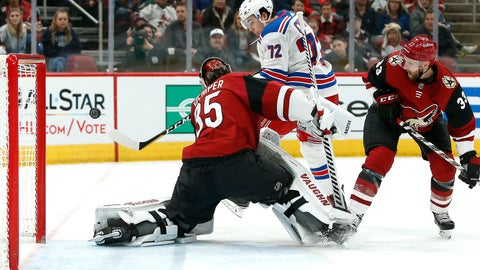 <p>               New York Rangers center Filip Chytil (72) attempts to shoot the puck past Arizona Coyotes goalie Darcy Kuemper (35) as Arizona Coyotes' Alex Goligoski (33) defends during the second period of an NHL hockey game, Sunday, Jan. 6, 2019, in Glendale, Ariz. (AP Photo/Ralph Freso)             </p>