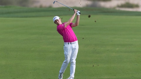 <p>               Matthew Fitzpatrick of England hits his second shot on the 14th hole during round two of the Dubai Desert Classic golf tournament in Dubai, United Arab Emirates, Friday, Jan. 25, 2019. (AP Photo/Neville Hopwood)             </p>