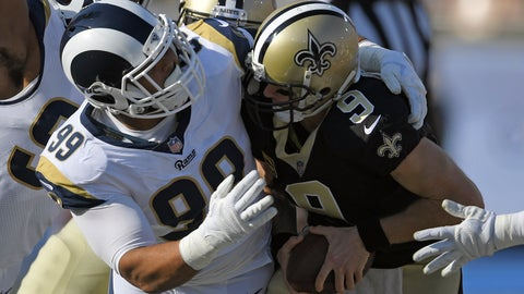 <p>               FILE - In this Nov. 26, 2017, file photo, New Orleans Saints quarterback Drew Brees, right, gets sacked by Los Angeles Rams defensive end Aaron Donald during the first half of an NFL football game, in Los Angeles. The Rams, with unanimous All-Pro defensive tackle Aaron Donald take on the Saints in the NFC Championship on Sunday, Jan. 20, 2019.(AP Photo/Mark J. Terrill, File)             </p>