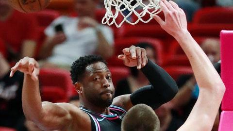 <p>               Miami Heat guard Dwyane Wade, rear, passes past Denver Nuggets center Nikola Jokic (15) during the first half of an NBA basketball game, Tuesday, Jan. 8, 2019, in Miami. (AP Photo/Wilfredo Lee)             </p>