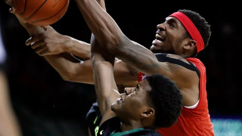 <p>               Baylor's Jared Butler, bottom, and Texas Tech forward Tariq Owens, top, compete for a rebound during the first half of an NCAA college basketball game Saturday, Jan. 19, 2019, in Waco, Texas. (AP Photo/Tony Gutierrez)             </p>
