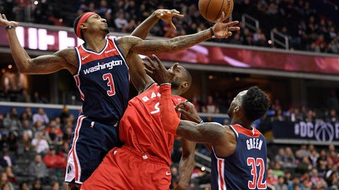 <p>               Washington Wizards guard Bradley Beal (3) and forward Jeff Green (32) battle for the rebound against Toronto Raptors forward Serge Ibaka (9) during the first half of an NBA basketball game, Sunday, Jan. 13, 2019, in Washington. (AP Photo/Nick Wass)             </p>