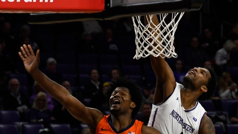 <p>               Illinois guard Andres Feliz (10) misses a shot as Northwestern forward Vic Law (4) deflects it during the second half of an NCAA college basketball game on Sunday, Jan. 6, 2019, in Evanston, Ill. (AP Photo/Matt Marton)             </p>