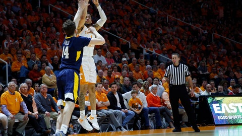 <p>               Tennessee guard Lamonte Turner (1) shoots over West Virginia guard Chase Harler (14) in the first half of an NCAA college basketball game Saturday, Jan. 26, 2019, in Knoxville, Tenn. (AP Photo/Wade Payne)             </p>