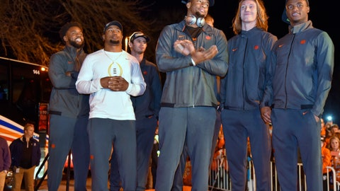 <p>               Clemson's Christian Wilkins, Adam Choice, Hunter Renfrow, Clelin Ferrell, Trevor Lawrence and Trayvon Mullen, from left, stand on a stage after the team returned to campus Tuesday, Jan. 8, 2019, in Clemson, S.C., the day after a 44-16 win over Alabama in the College Football Playoff championship game. (AP Photo/Richard Shiro)             </p>