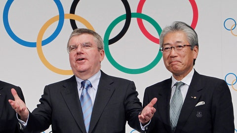"""<p>               FILE - This Nov. 20, 2013, file photo shows Japan Olympic Committee President Tsunekazu Takeda, right, and  International Olympic Committee (IOC) President Thomas Bach, left, following a press conference in Tokyo. France's financial crimes office says International Olympic Committee member Takeda is being investigated for corruption related to the 2020 Tokyo Olympics. The National Financial Prosecutors office says Takeda, the president of the Japanese Olympic Committee, was placed under formal investigation for """"active corruption"""" on Dec. 10.(AP Photo/Junji Kurokawa, File)             </p>"""