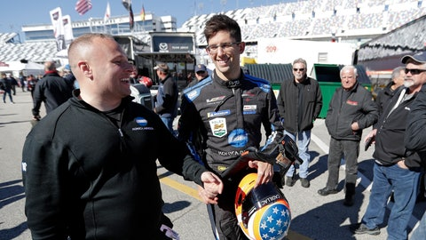 <p>               Jordan Taylor, center, makes his way to the garages after a practice session for the IMSA 24 hour race at Daytona International Speedway, Friday, Jan. 25, 2019, in Daytona Beach, Fla. (AP Photo/John Raoux)             </p>