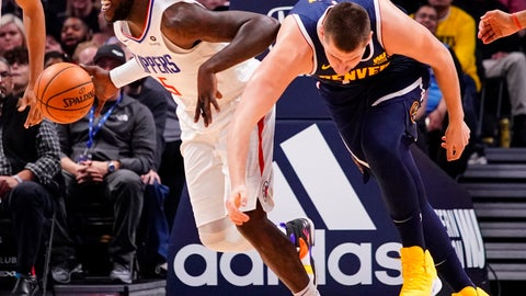 <p>               CORRECTS TO CLIPPERS' MONTREZL HARRELL NOT JOHNATHAN MOTLEY - Los Angeles Clippers forward Montrezl Harrell (5) steals the ball from Denver Nuggets center Nikola Jokic (15) during the second quarter of an NBA basketball game Thursday, Jan. 10, 2019, in Denver. (AP Photo/Jack Dempsey)             </p>