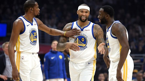 <p>               Golden State Warriors forward Kevin Durant, left, pats center DeMarcus Cousins, center, on the chest as forward Draymond Green smiles during the first half of the team's NBA basketball game against the Los Angeles Clippers on Friday, Jan. 18, 2019, in Los Angeles. (AP Photo/Mark J. Terrill)             </p>