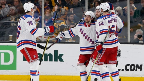 <p>               New York Rangers center Mika Zibanejad, second from right, is congratulated by teammates defenseman Brady Skjei (76), right wing Mats Zuccarello, second left, and defenseman Adam McQuaid (54) after scoring a goal during the second period of an NHL hockey game against the Boston Bruins, Saturday, Jan. 19, 2019, in Boston. (AP Photo/Mary Schwalm)             </p>