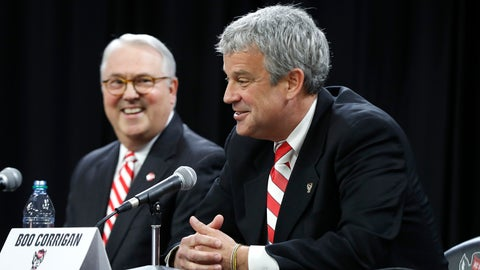 <p>               North Carolina State chancellor Randy Woodson, left, laughs with Boo Corrigan after Corrigan was introduced as N.C. State's new athletic director during a press conference at Reynolds Coliseum in Raleigh, N.C., Thursday, Jan. 31, 2019. (Ethan Hyman/The News & Observer via AP)             </p>
